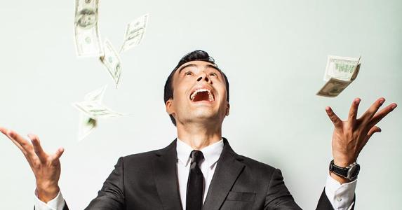 man-in-suit-excited-about-money-falling_573x300