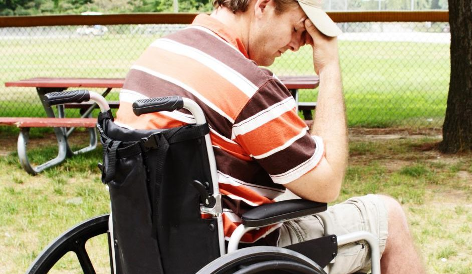depressed-man-in-wheelchair